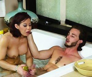 Busty redhead babe Ryder Skye blows her man in a bath tub
