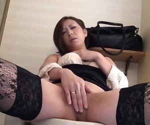 Asian in stockings pisses