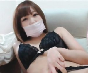 Asian in lingerie touching her hairy pussy